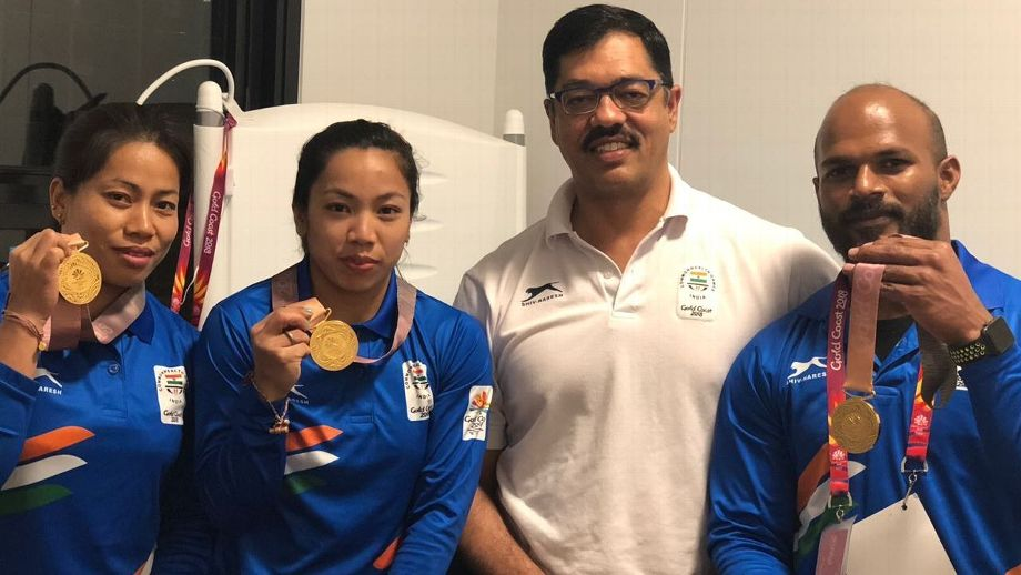National weightlifting coach Vijay Sharma with the weightlifters (Image: Twitter)