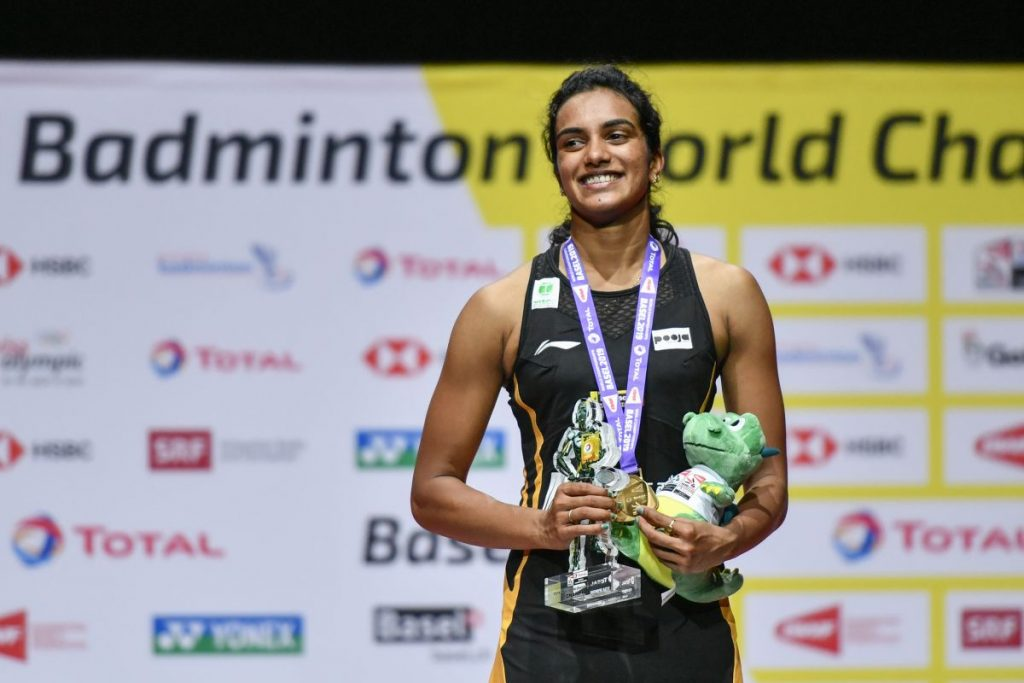 First-placed India's Pusarla Venkata Sindhu poses on with the gold medal during the podium ceremony after her victory over Japan's Nozomi Okuhara during their women's singles final match at the BWF Badminton World Championships