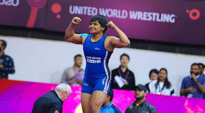 Divya Kakran celebrates after her gold medal winning performance. (Image: unitedworldwrestling)