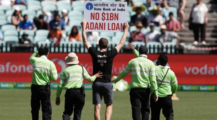 Protestors with Adani signs at the SCG (Source: Twitter-Raunak Kapoor)